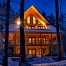 Log home at night, winter