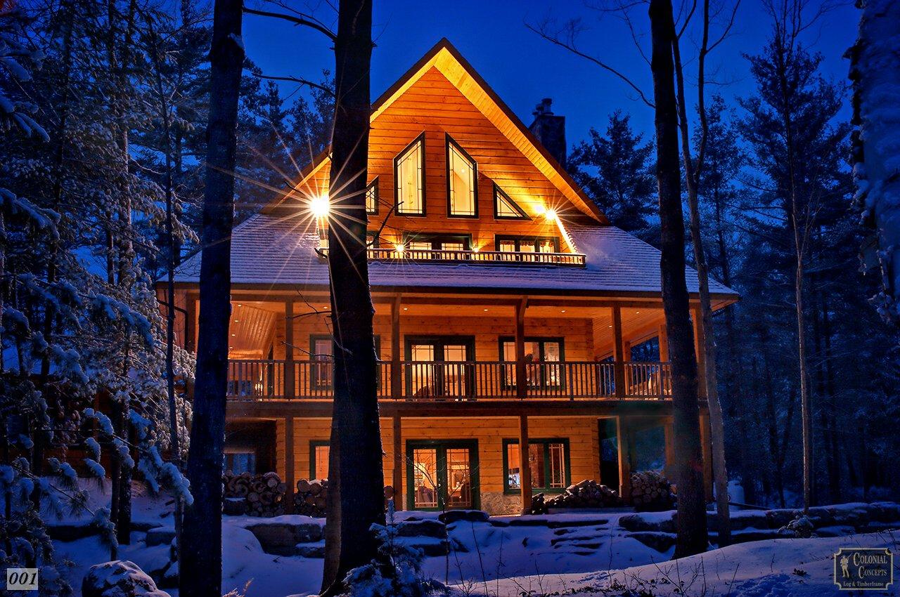 Log home at night, winter