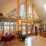Log home bedroom, cathedral ceiling, wood beams, lake view