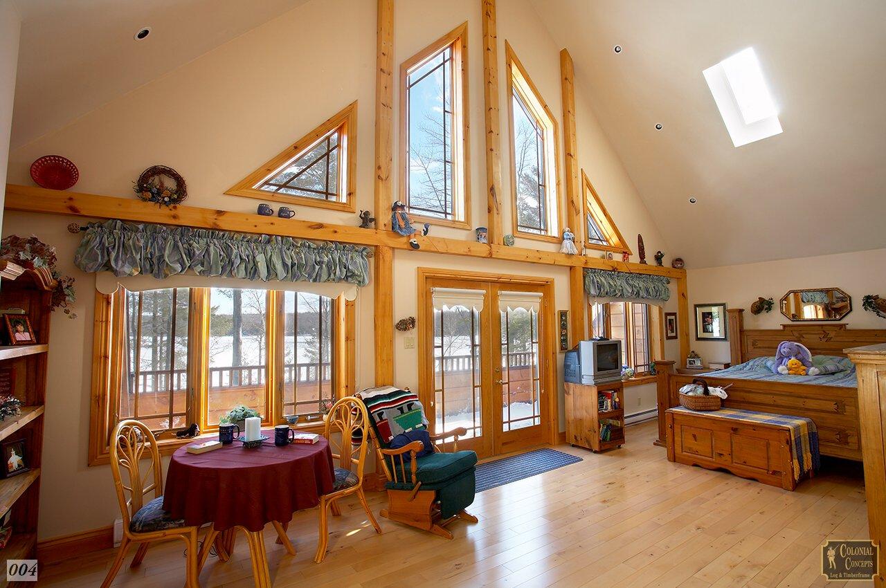 Log home bedroom, cathedral ceiling, wood beams, lake view