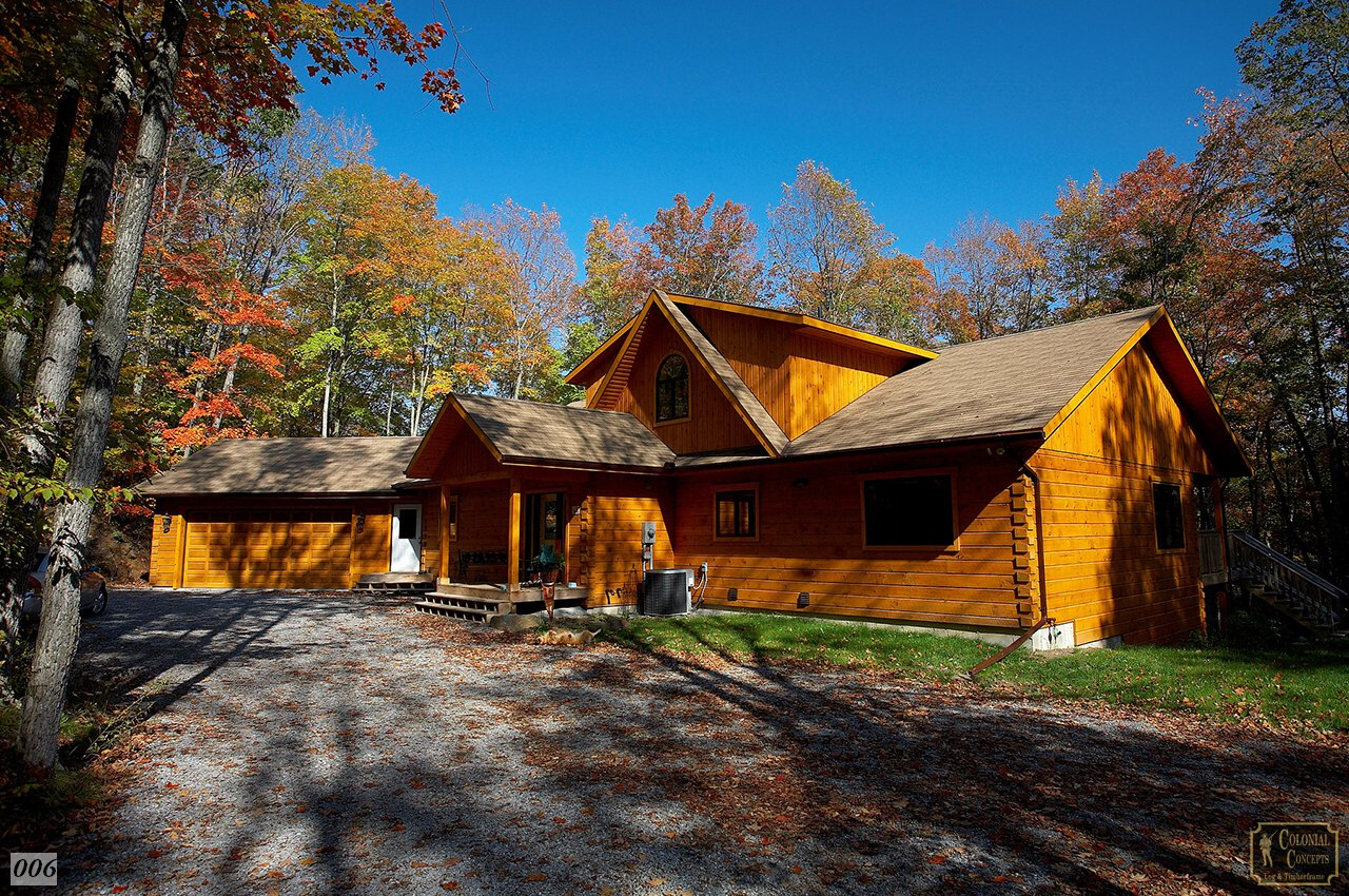 Photo gallery colonial concepts log timberframe for Colonial log homes