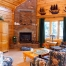 Log home living room with fireplace