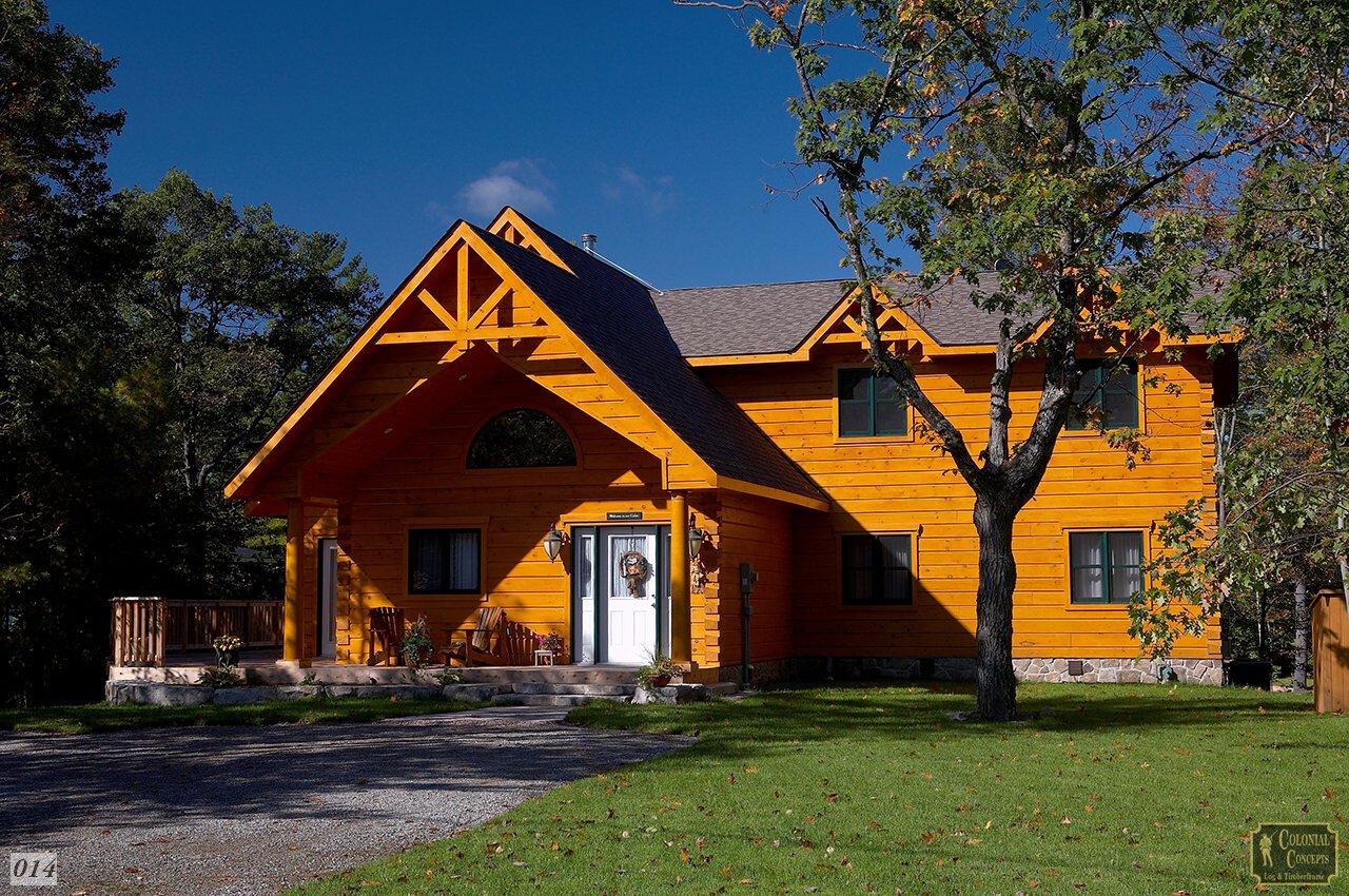 Log home with blue sky