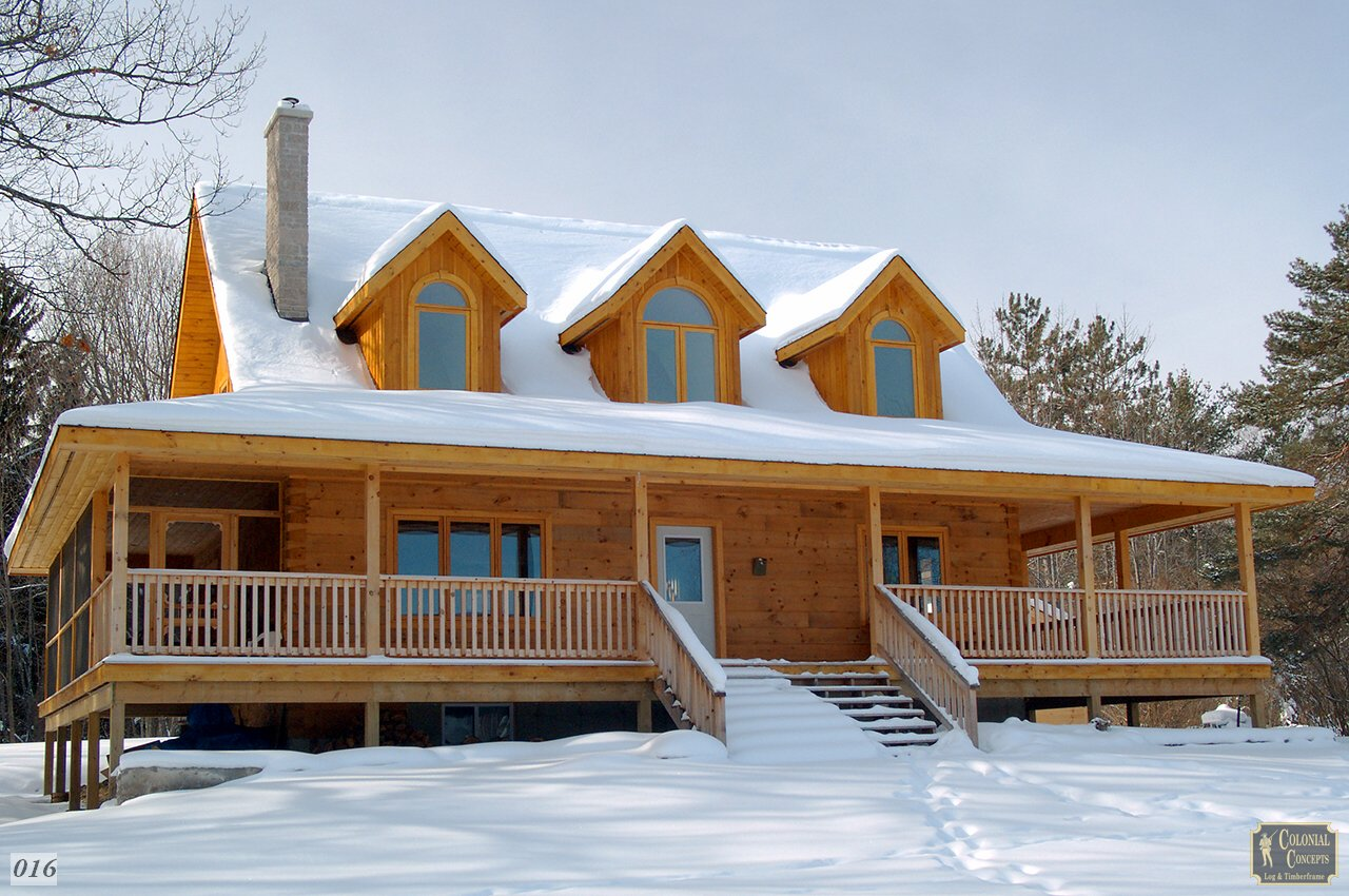 Log home in winter, snow