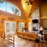 Log home living room with fireplace and lake