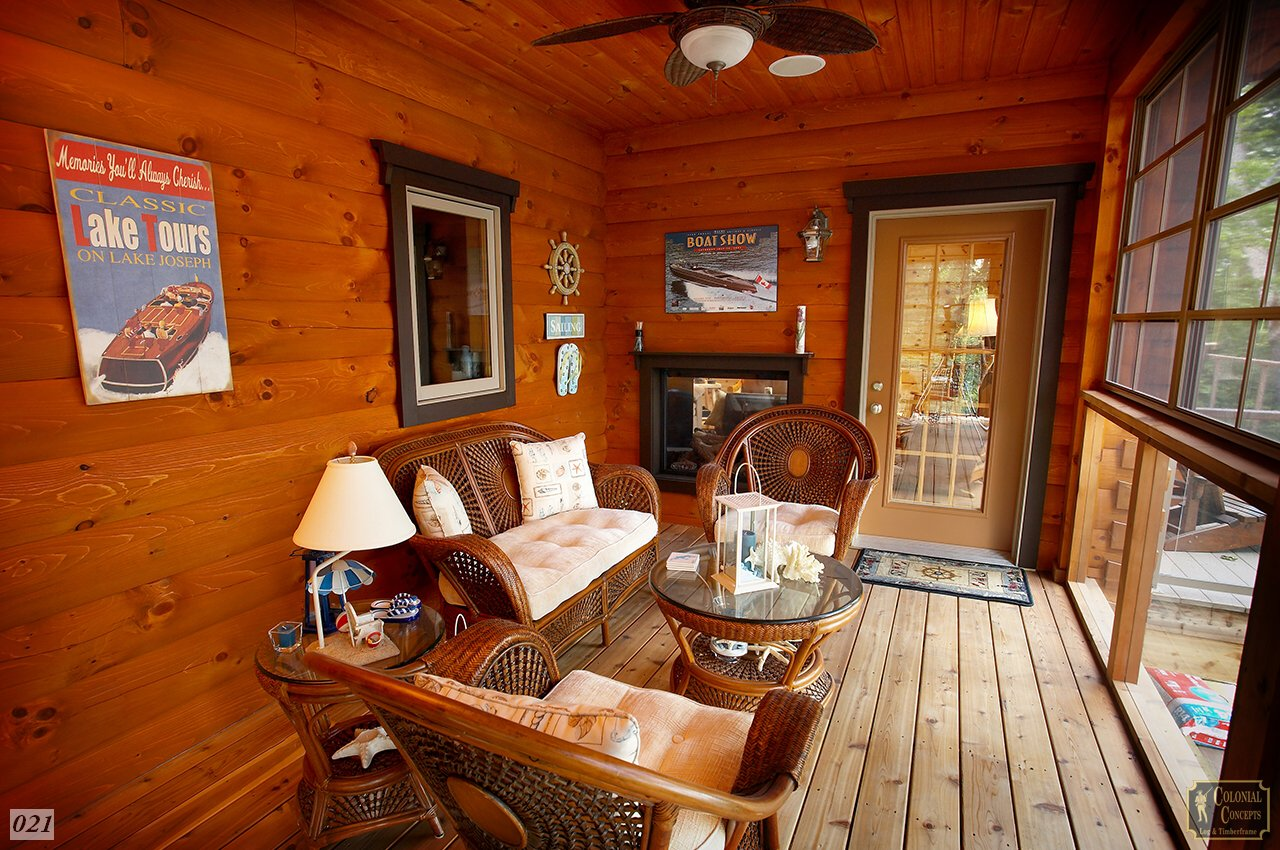 Log home covered and screened in porch
