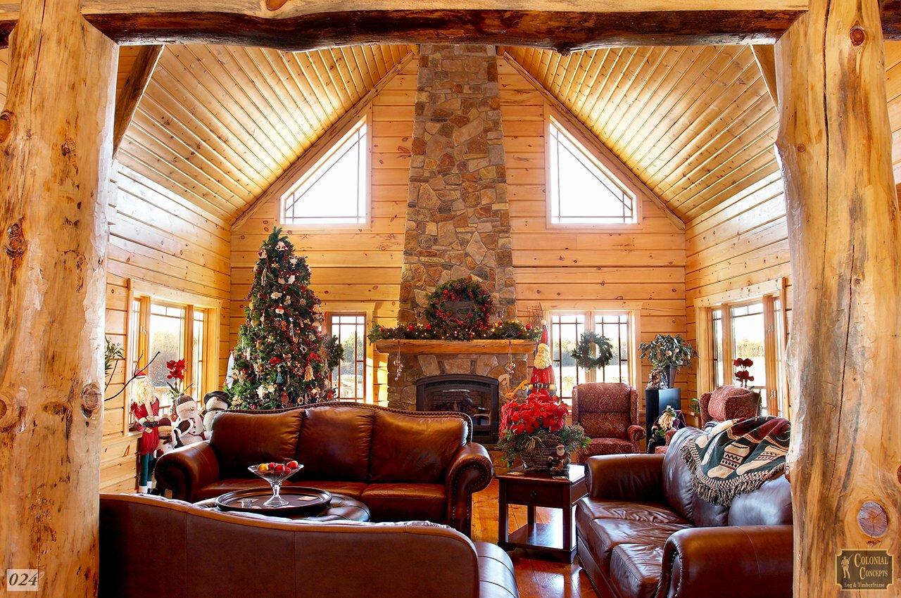Log home living room with fireplace at Christmas