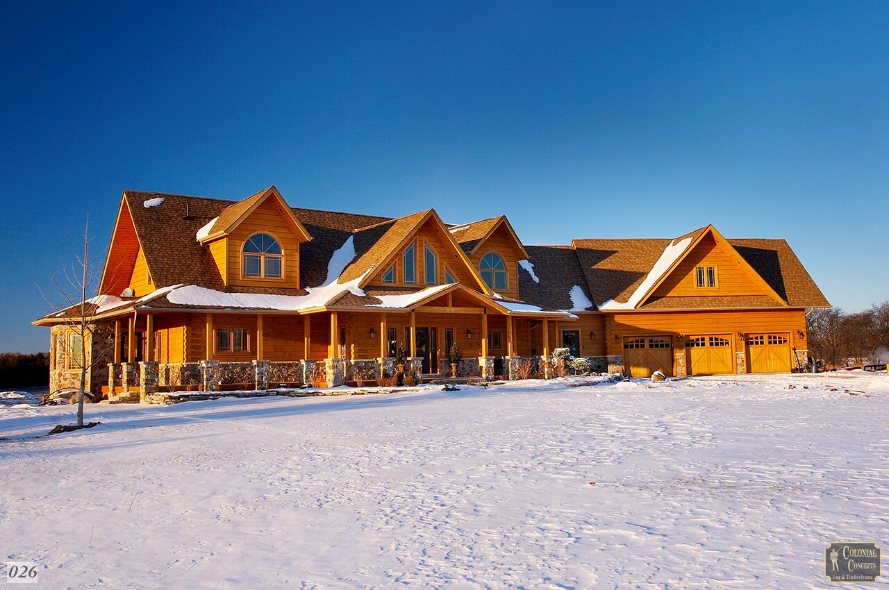 Log home, large, in winter and snow