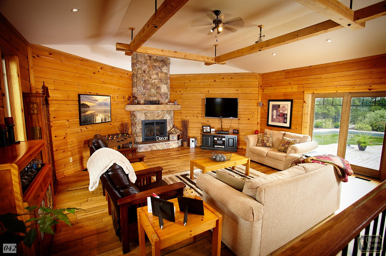 log home living room with stone fireplace