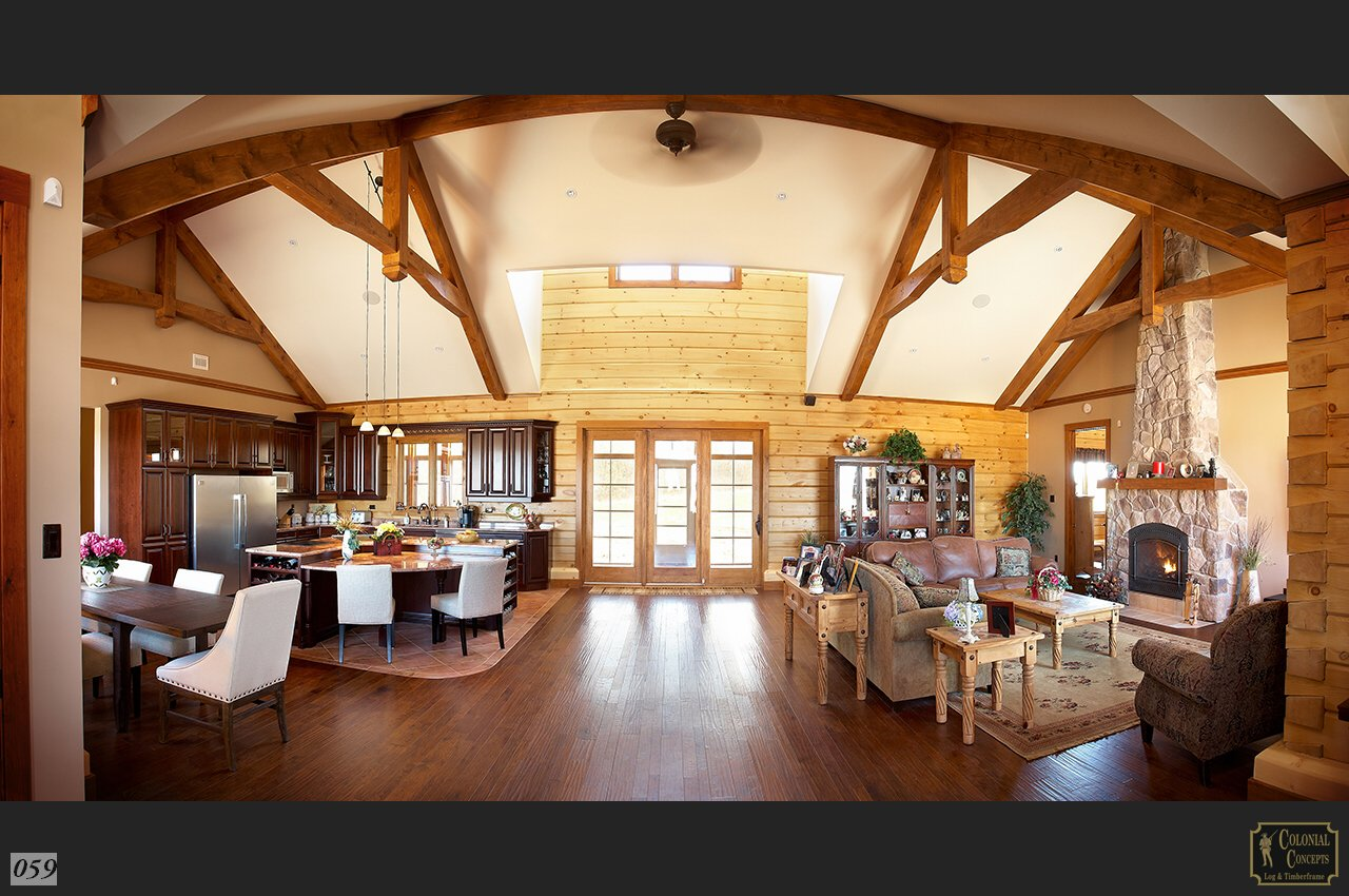 log home with post and beam vaulted ceiling