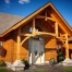 log home with custom post and beam timberframe entry