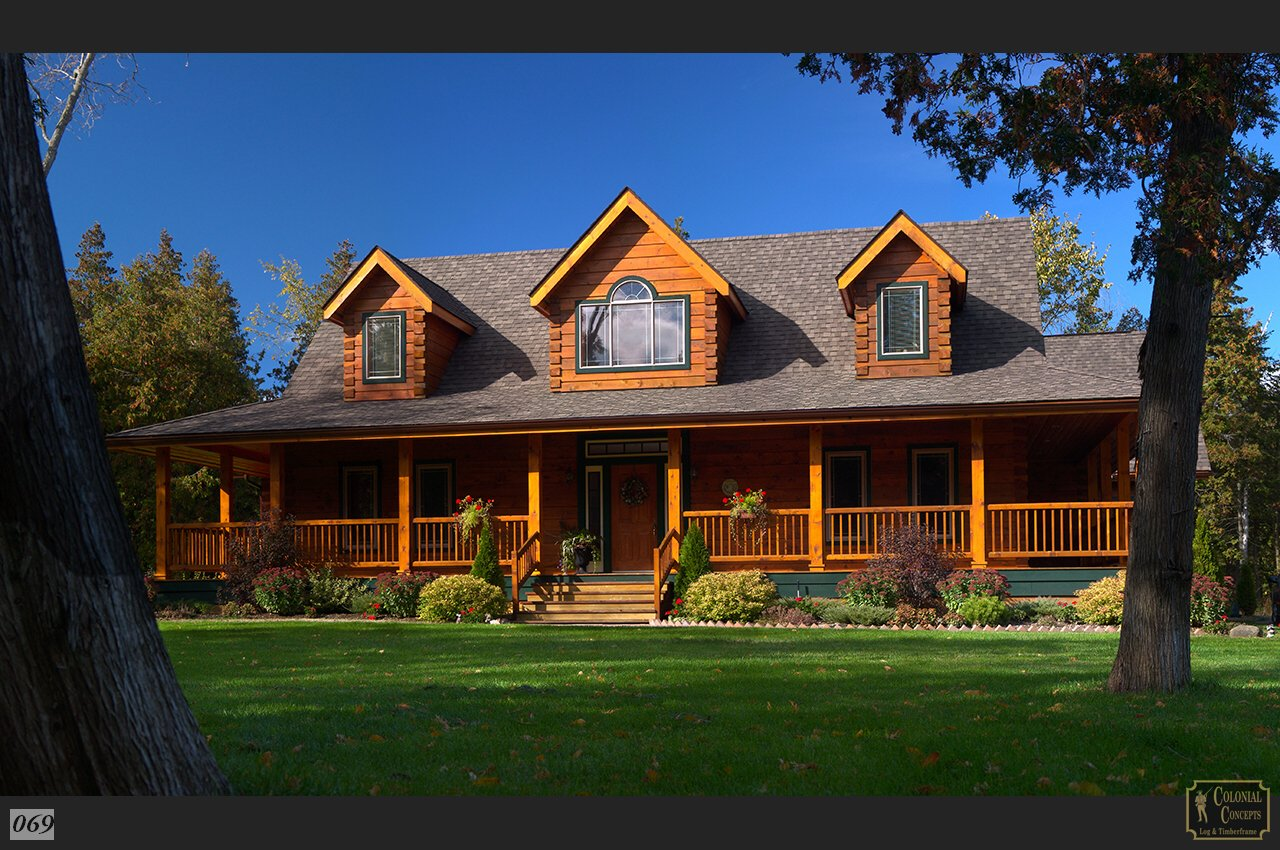Log home petersburg model with dormers and covered porch for Colonial log homes