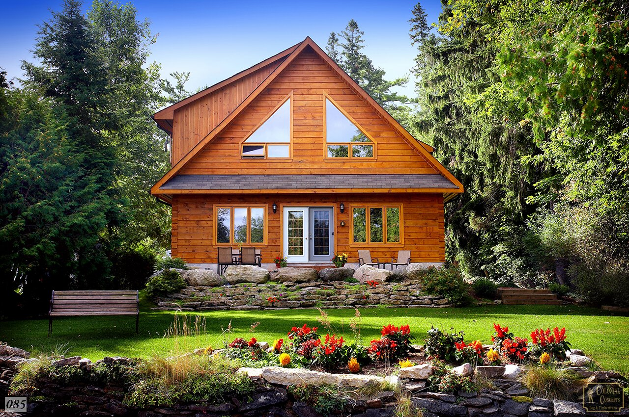 log home on the lake with garden