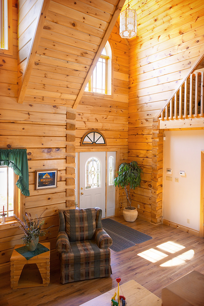 log home office model foyer