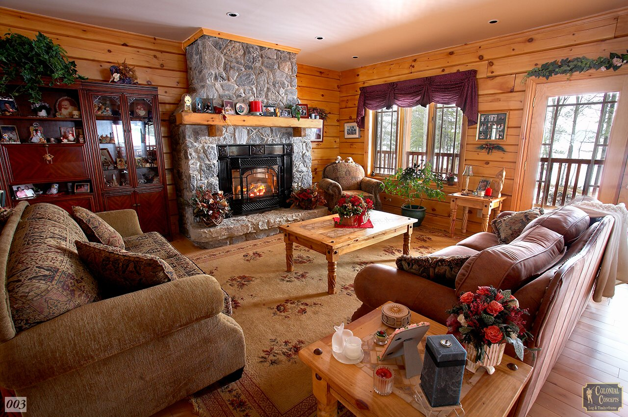 Log home living room with fireplace, Peterborough Ontario