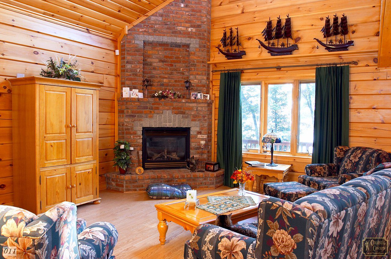 Log home living room with fireplace, near Lindsay Ontario