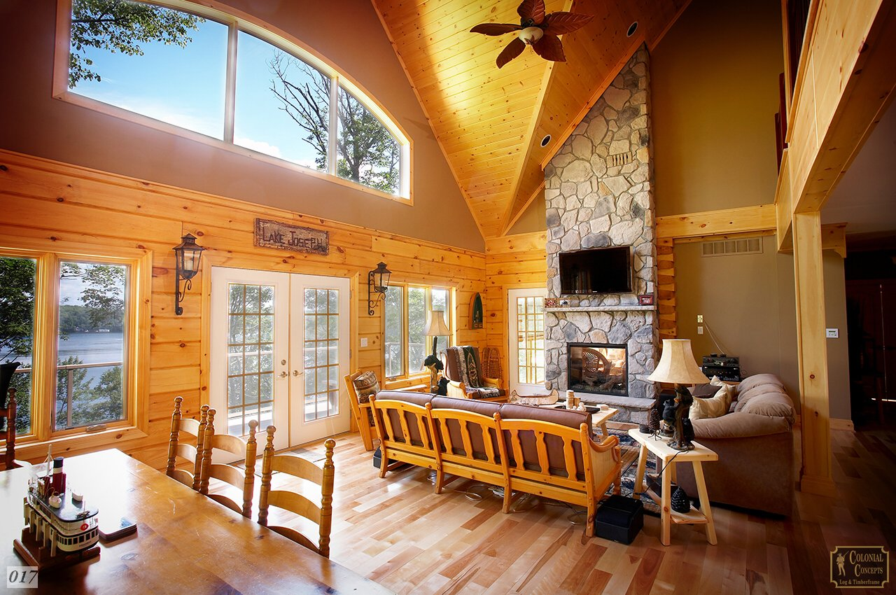 Log home living room with fireplace and lake, Muskoka Ontario