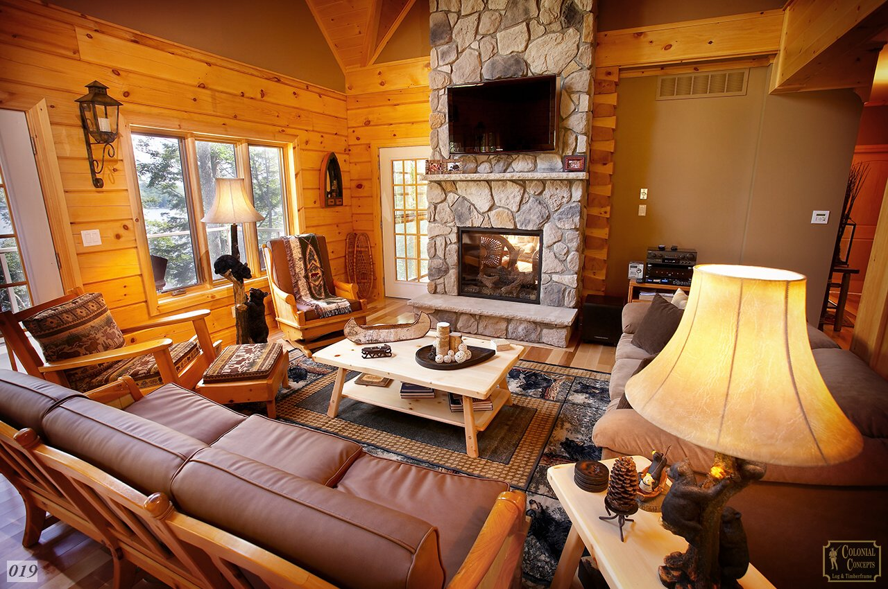 Log home, cozy living room with fireplace, Muskoka Ontario